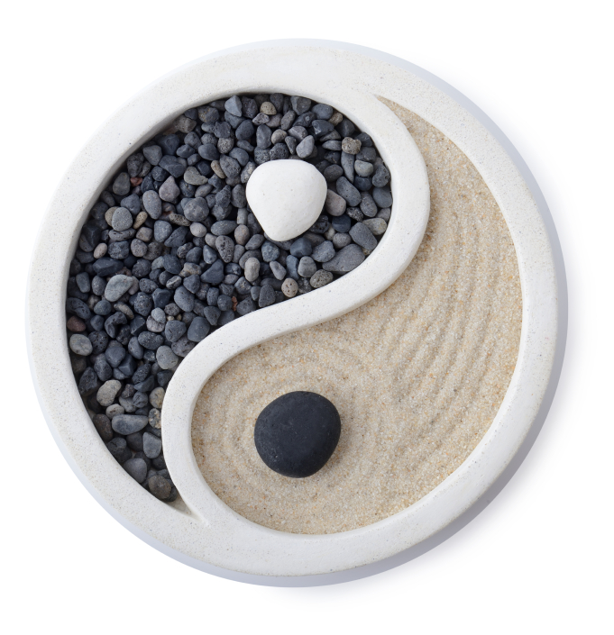 a small zen garden ying yang symbol isolated on white